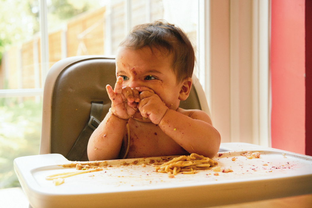 Baby covered in food