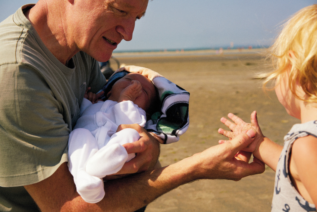 Father on the beach with baby